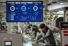 Production data are presented on a screen of a digital management system at a factory in Jindong District, Jinhua, east China's Zhejiang Province, March 15, 2021. (Photo by Hu Xiaofei/People's Daily Online)