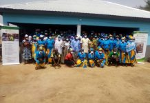 Photo of cross section of the women at the commissioning of the processing centres