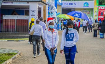 """People visit an expo in Kigali, capital city of Rwanda, Dec. 14, 2020. Rwandan Minister of Health Daniel Ngamije on Sunday warned the COVID-19 pandemic has reached a """"critical stage"""" in the country, with an ongoing spike in new cases and increase in deaths. (Photo by Cyril Ndegeya/Xinhua)"""