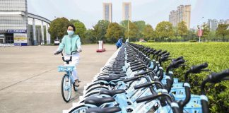 A teacher of the Huaiyin Institute of Technology in Huai'an, east China's Jiangsu province, rides a shared bike in the campus, April 18, 2020. (Photo by Zhao Qirui/People's Daily Online)