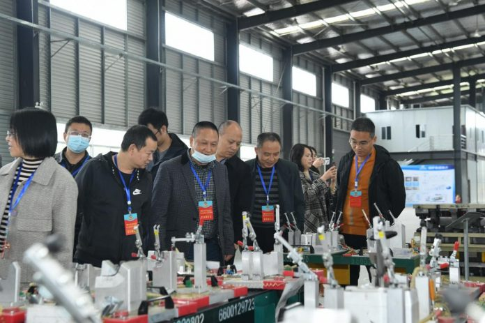 Photo taken on Oct. 16, 2020, shows members of the Chinese People's Political Consultative Conference committee of Peng'an county, southwest China's Sichuan province, visiting an auto parts industrial park of the county to help enterprises solve difficulties with production, operation, as well as research and development. (Photo by Guo Anping/People's Daily Online)