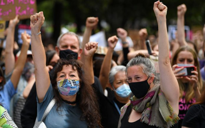 Protesters gather during the Women's March 4 Justice in Melbourne, Monday, March 15, 2021. Marches are being held around the country to raise awareness of sexual harassment against women in government and workplaces. (AAP Image/James Ross) NO ARCHIVING
