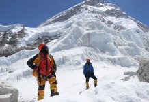 FILED - Khim Lal Gautam (left) looks up the path on the ascent to Mount Everest in 2019. A team of climbers belonging to Bahrain's Royal Guard have arrived in Nepal for the spring expedition of Mount Everest, authorities said on Tuesday, the first arrivals since 2019. Photo: Tshiring Jangbu Sherp/privat/dpa - ATTENTION: editorial use only in connection with the latest coverage and only if the credit mentioned above is referenced in full