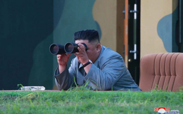 HANDOUT - North Korean leader Kim Jong-un watches a missile launch from a site near the North's eastern coastal town of Wonsan. Two missiles tested by North Korea on Thursday were a