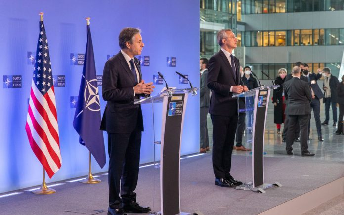 HANDOUT - 23 March 2021, Belgium, Brussels: NATO Secretary General Jens Stoltenberg (R) and US Secretary of State Antony Blinken give a press conference on the sidelines of a meeting of NATO foreign ministers at NATO headquarters. Photo: -/NATO/dpa - ATTENTION: editorial use only and only if the credit mentioned above is referenced in full