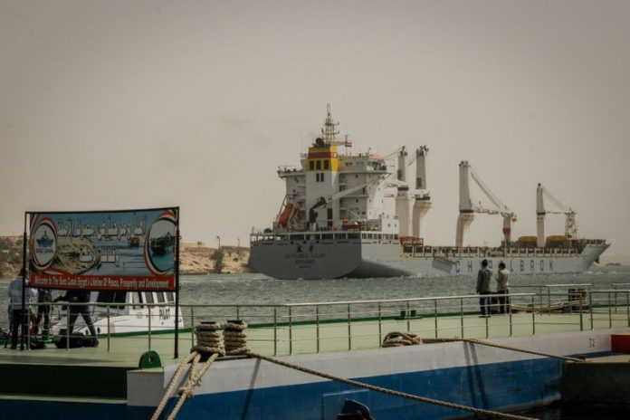 A ship sails along the waterway of the Suez Canal after the resumption of the navigation traffic following the partial refloating of the