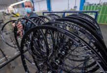 An employee finishes bicycles at the Union E-Mobility firm in Sangerhausen, Germany, on Tuesday. German business confidence surged in March on hopes of a rebound in Europe's biggest economy and an eventual end to tough anti-coronavirus lockdown measures. Photo: Hendrik Schmidt/dpa-Zentralbild/dpa