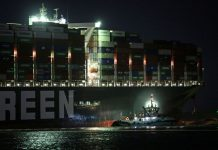 "27 March 2021, Egypt, Suez: A general view of ""Ever Given"", a container ship operated by the Evergreen Marine Corporation which is currently stuck in the Suez canal, during a tugging attempt to re-float it. The state-run Suez Canal Authority (SCA) announced that nearly 17,000 cubic meters of sand have been dredged around the ship after navigation through the Suez Canal has been temporarily suspended until the full refloating of the Panamanian massive cargo vessel which ran aground on Tuesday in the southern end of the Suez Canal and blocked the traffic in both directions. The ship turned sideways in the Canal, while on the route from China to Rotterdam, due to reduced visibility that resulted from a dust storm hitting the area, according to SCA. Photo: Fadell Dawod/dpa"