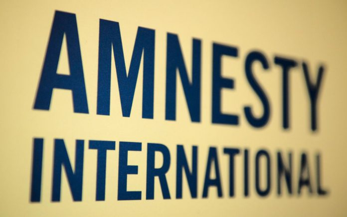 FILED - The logo of the human rights organization Amnesty International is pictured in Berlin. Photo: Sebastian Kahnert/dpa