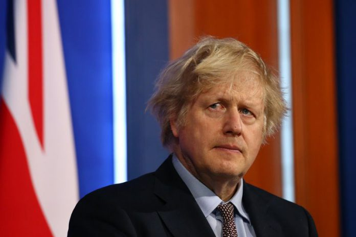 29 March 2021, United Kingdom, London: UK Prime Minister Boris Johnson reacts during a press conference on COVID-19 pandemic from the new Downing Street Briefing Room. Photo: Hollie Adams/PA Wire/dpa