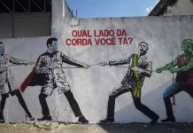 dpatop - June 17, 2020, SaO Paulo, São Paulo, Brazil: S÷O PAULO, BRASIL - 17 DE JUNHO: A view of a wall with a graffiti depicting Brazilian President Jair Bolsonaro and a figure representing the coronavirus in a tug of war against health workers with a phrase that reads in portuguese ''Which side of the rope are you on?'' amidst the coronavirus (COVID-19) pandemic on June 17, 2020 in Sao Paulo, Brazil. (Credit Image: © Cris Faga/ZUMA Wire Photo: Cris Faga/ZUMA Wire/dpa