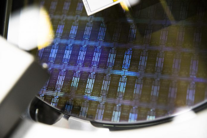 A wafer is processed in a single wafer diffusion mechanism inside the GlobalFoundries semiconductor manufacturing facility in Malta, New York, US. GlobalFoundries plans to invest €400mil (RM1.94bil) to expand its clean rooms in Dresden. — Bloomberg