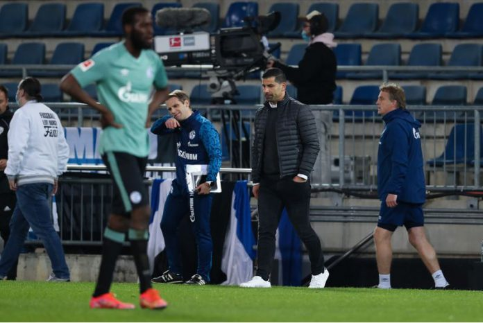 FILED - Football: Bundesliga, Matchday 30, Arminia Bielefeld - FC Schalke 04, Schüco Arena: Schalke's coach Dimitrios Grammozis (2nd from right) reacts after the final whistle with relegation confirmed. IMPORTANT NOTE: In accordance with the regulations of the DFL Deutsche Fußball Liga and the DFB Deutscher Fußball-Bund (German Football Association), it is prohibited to use or have used photographs taken in the stadium and/or of the match in the form of sequence pictures and/or video-like photo series. Photo: Friso Gentsch/dpa Pool/dpa