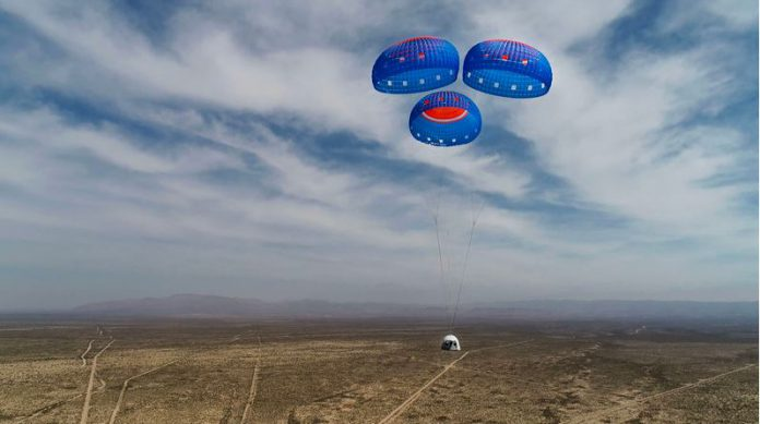HANDOUT - This handout photo shows the New Shephard crew capsule descending from space on Mission NS-15 on April 14, 2021 Handout (Credit Origin Blue Photo: Erich Braunsperger/dpa