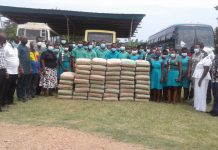 Salvation army church presenting 50 bags of cement to salvation army SHS at Akyem Wenchi in the Eastern Region