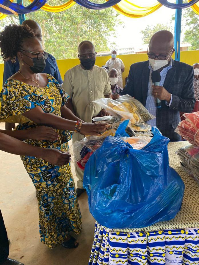 Dr Nana Ato Arthur handing over the football kits to the reps of the schools and digging the ground for the construction of the clinic to begin.