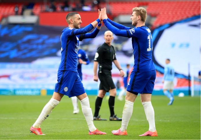 Chelsea's Hakim Ziyech celebrates scoring his side's first goal with teammate Timo Werner (R) during the English FA Cup semi-final soccer match between Chelsea FC and Manchester City at Wembley Stadium. Photo: Adam Davy/PA Wire/dpa