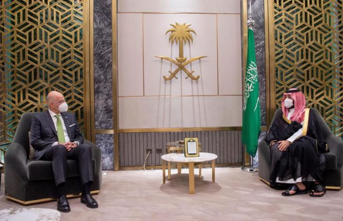 20 April 2021, Saudi Arabia, Riyadh: Crown Prince of Saudi Arabia Mohammed bin Salman (R) speaks with Greek Foreign Minister Nikos Dendias during their meeting in Riyadh. Photo: -/Saudi Press Agency/dpa