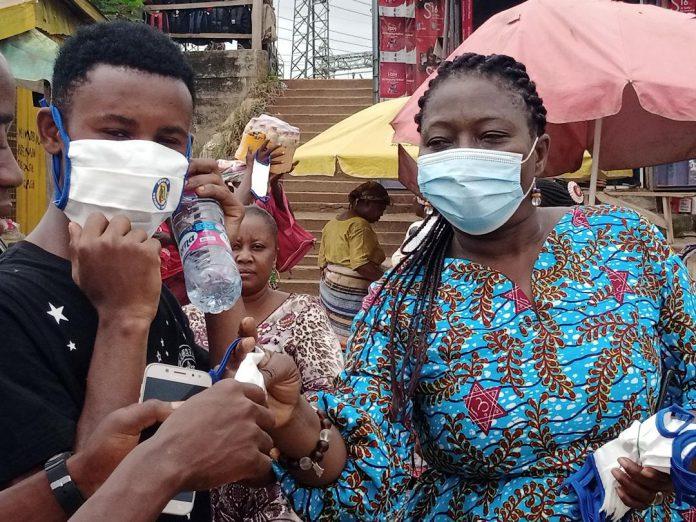 Mr Akanbong distributing some nose masks