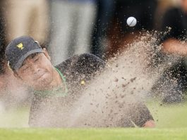 FILED - Japan's Hideki Matsuyama plays his shot from a bunker in this file photo from December 12, 2019, at the 2019 Presidents Cup golf competition at the Royal Melbourne Golf Club. Photo: Scott Barbour/AAP/dpa