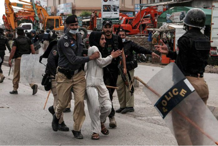 13 April 2021, Pakistan, Rawalpindi: Police arrests a protester during a protest by the Islamist far-right Tehreek-e-Labaik Pakistan (TLP) group protest against the detention of group's chief Saad Hussain Rizvi. Photo: Ppi/PPI via ZUMA Wire/dpa