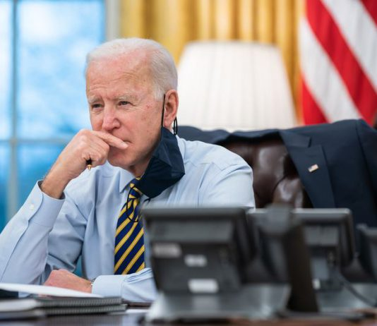 President Joe Biden gets briefed by Liz Sherwood Randall, Julie Rodriguez and participates in a conference phone call with governors affected by the snow storm in the middle of the country in the Oval Office, February 16, 2021, in Washington. Photo: White House/ZUMA Wire/dpa