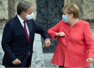 dpatop - Chancellor Angela Merkel and Armin Laschet Photo: Federico Gambarini/dpa-Pool/dpa