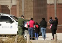 Migrants detained after crossing border in El Paso, Texas (Reuters)