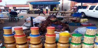 Mrs. Rabiatu busily selling her products at Adum in Kumasi