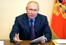 HANDOUT - 15 April 2021, Russia, Novo-Ogaryovo: Russian President Vladimir Putin attends a meeting of the State Council Presidium and the Agency for Strategic Initiatives, held via video conference, at the Novo-Ogaryovo state residence. Photo: -/Kremlin/dpa - ATTENTION: editorial use only and only if the credit mentioned above is referenced in full
