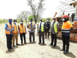 Photo of Mr Stephen Mahamudu Yakubu (third from right) with officials from the RCC, Zoomlion Ghana Limited, and the Contractor