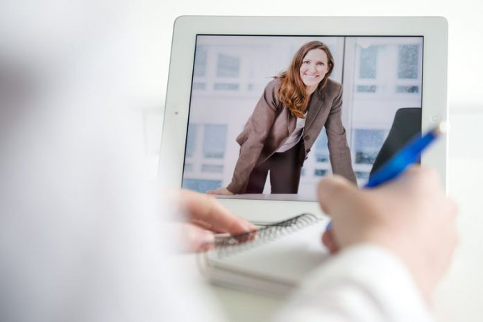 FILED - Next time you have to do a presentation or job interview online, try leaning forward. Experts say this will help you come across as confident and professional. Photo: Franziska Gabbert/dpa