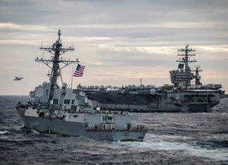 FILED - The Arleigh Burke-class guided-missile destroyer USS Sterett (L) sails alongside the USS Nimitz aircraft carrier and the USS Theodore Roosevelt aircraft carrier (not pictured) during a military exercises conducted in the disputed waters of the South China Sea. Top defence officials from the Philippines and the United States held talks on Sunday, including on the disputed South China Sea, where large numbers of Chinese vessels had been spotted recently. Photo: Markus Castaneda/US Pacific Fleet/dpa - ATTENTION: editorial use only and only if the credit mentioned above is referenced in full