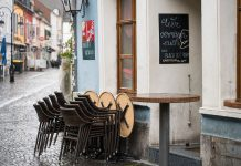 There are chairs in the outdoor area of a restaurant in the city centre. Tomorrow, Tuesday, outdoor restaurants are allowed to reopen under certain conditions. Photo: Oliver Dietze/dpa