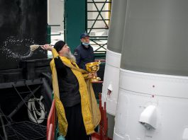 HANDOUT - Father Sergei, a Russian Orthodox priest, blesses a Soyuz rocket on Thursday, a day before its launch fromKazakhstan to rendezvous with the International Space Station. The capsule, carrying three astronauts, took off successfully from the Baikonur spaceport on Friday. Photo: Bill Ingalls/NASA/dpa - ATTENTION: editorial use only and only if the credit mentioned above is referenced in full