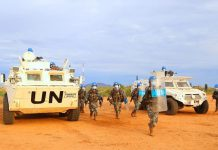 Chinese peacekeeping infantry battalion joins a drill conducted by the United Nations Mission in the Republic of South Sudan and United Nations Police for better peacekeeping amid COVID-19, April 24. (Photo by JiaFangwen/People's Daily Online)