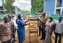 some members of the group, the school management and some of the students (above) and Rev. Dr. Phyllis Donkor making a symbolic presentation of one of the desk to Mr Appiah