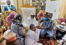 Madam Kudjordji Sophia-Lisa, Chief Corporate Communication Officer for the Group presenting the items to Alhaji Laif, Protocol Officer for the Chief Imam and Alhaji Ahmed Suleman Anderson, Deputy Ameer III, Ahmadiyya Muslim Mission, Ghana and receiving blessings from Sheikh Sharubutu.