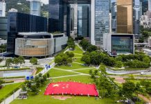 Pic: Hong Kong residents display China's national flag in the Tamar Park, Hong Kong on June 25, 2020 in support of the national security legislation for Hong Kong Special Administrative Region. (Xinhua)