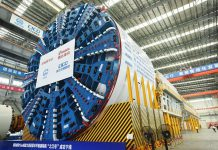 A 15-meter diameter super-large shield tunneling machine that can balance water and mud roll off the production line in east China's Zhejiang province, May 9, 2021. (Photo by Long Wei/People's Daily)