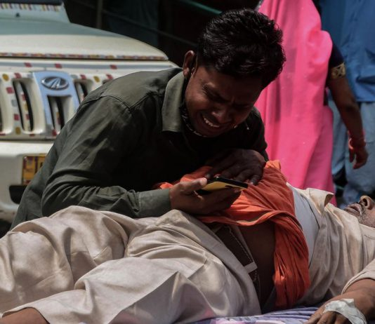 02 May 2021, India, Prayagraj: A man grieves near a relative suffering from coronavirus complications while waiting for admission at the Swaroop Rani Neharu hospital amid shortage in hospital beds and medical oxygen. Photo: Prabhat Kumar Verma/ZUMA Wire/dpa