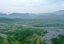 Photo taken on May 15, 2021 shows a bird's-eye view of massive photovoltaic panels on the mountains of Si'aowan village, Zhangxiang township. Xianju county, Taizhou, east China's Zhejiang province. (Photo by Yao Feng/People's Daily Online)