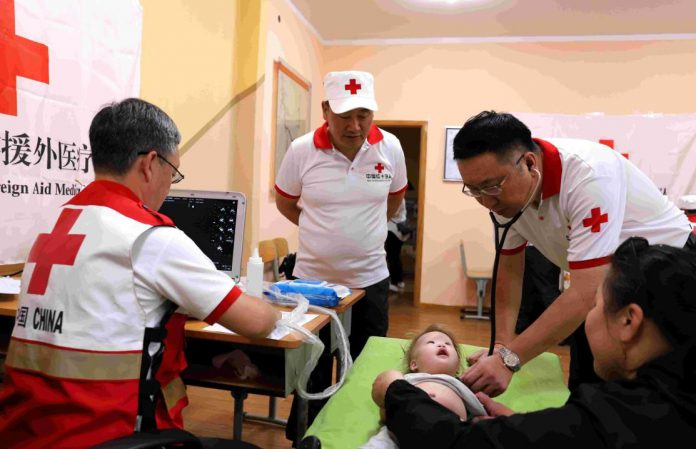 Chinese doctors treat a child in Ulan Bator, Mongolia, at a local hospital, June 25, 2019. (Photo by Huo Wen/People's Daily)
