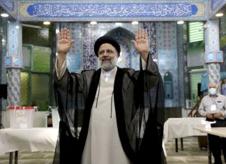 Ebrahim Raisi, a candidate in Iran's presidential elections waves to the media after casting his vote at a polling station in Tehran, Iran, June 18, 2021 (AP Photo/Ebrahim Noroozi)