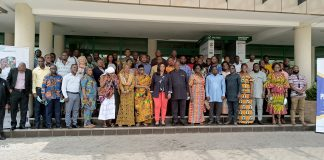 Gender Minister in a group photograph with participants at the national validation workshop.