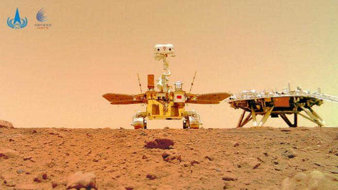Photo shows China's Mars rover, Zhurong, and its landing platform on Mars. (Photo/Official website of China National Space Administration)