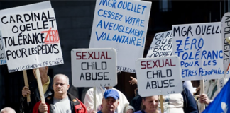 Members of the Duplessis Orphans group demonstrate outside the Notre Dame Basilica in Montreal, Friday, April 2, 2010. (THE CANADIAN PRESS/Graham Hughes)