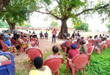 Mr Umar Yakubu Yaarun, Nadowli-Kaleo District Director, CHRAJ, addressing the community forum at Goli