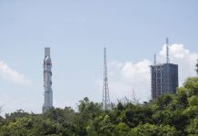 The combination of the Tianzhou-2 cargo spacecraft and a Long March-7 carrier rocket is transferred to the launching area, May 16. (Photo/Xinhua)