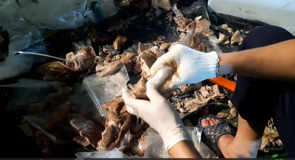 In this supplied photo, drugs were found hidden in pig organs at a factory in Hanoi.